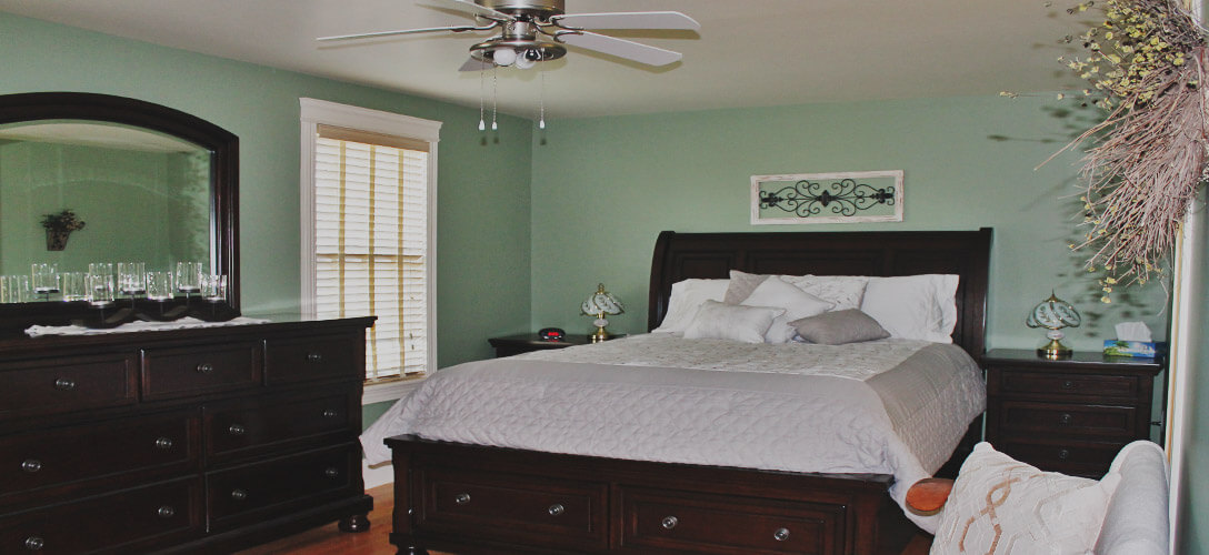 Interior photo of master bedroom.