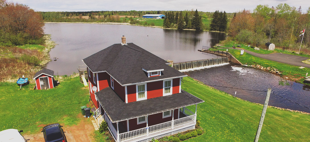 Overhead photo overlooking house towards pond.